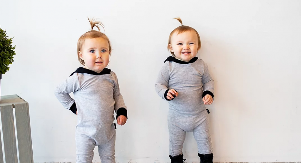 two babies wearing jones baby and co onesies