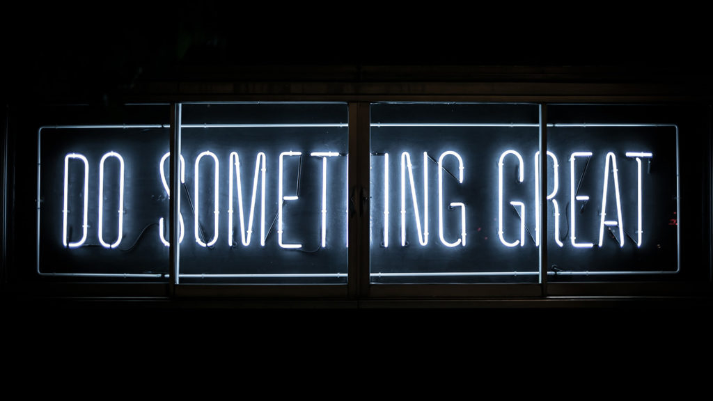 Glowing sign that says Do Something Great