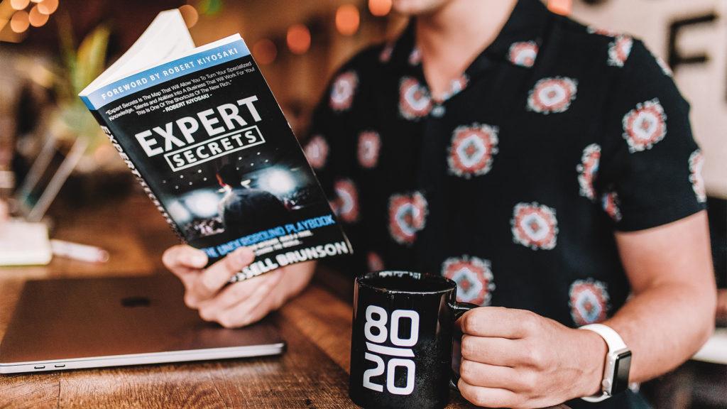 person reading business secrets book