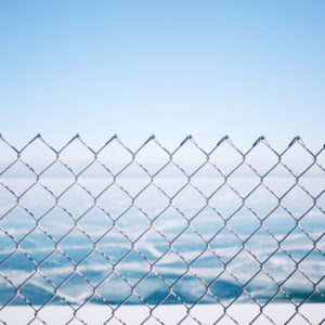 A fence overlooking the ocean
