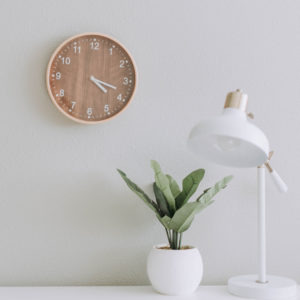 A clock above a desk